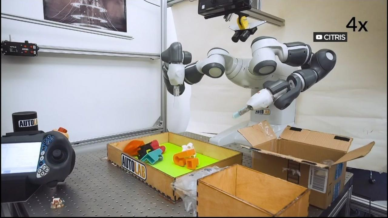 A robotic arm picks up objects in a U.C. Berkeley lab in this undated image.