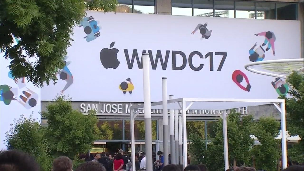 A crowd stands outside of the Apple Worldwide Developers Conference in San Jose, Calif. on Monday, June 5, 2017.