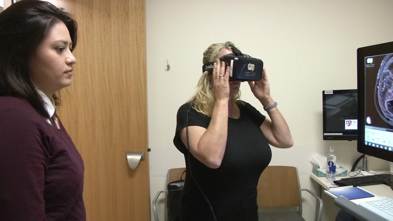 A patient uses virtual reality technology in a doctors office in this undated image.
