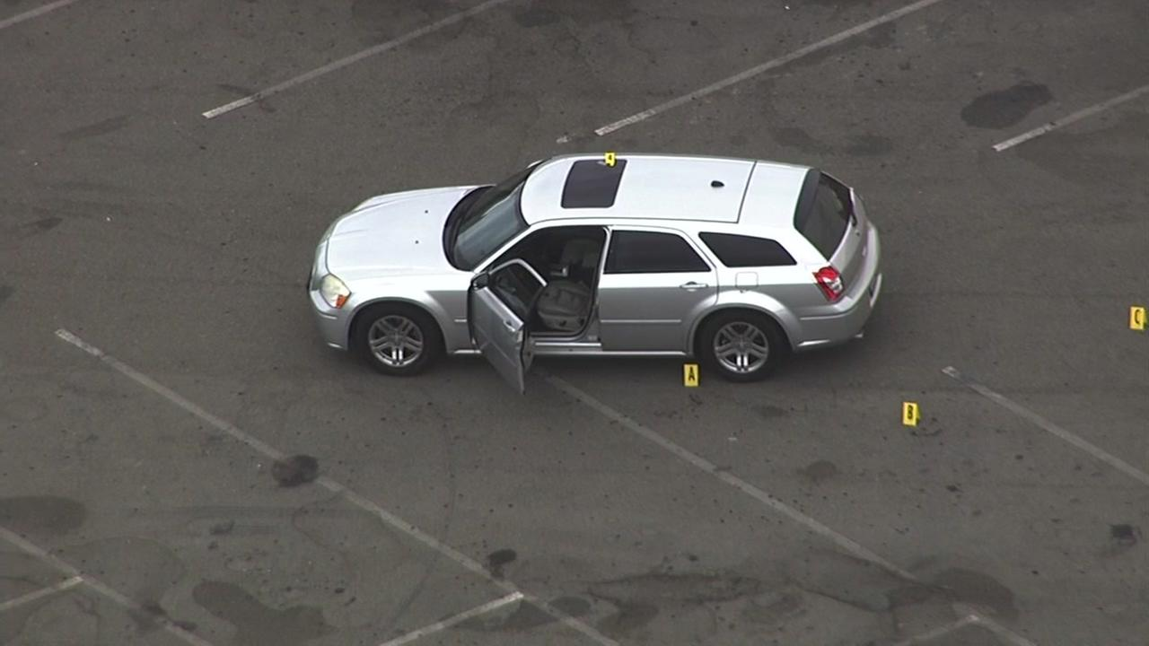 A white SUV is seen in the parking lot of the Fair Oaks Plaza Strip mall in Sunnyvale, Calif. on Thursday, June 8, 2017.