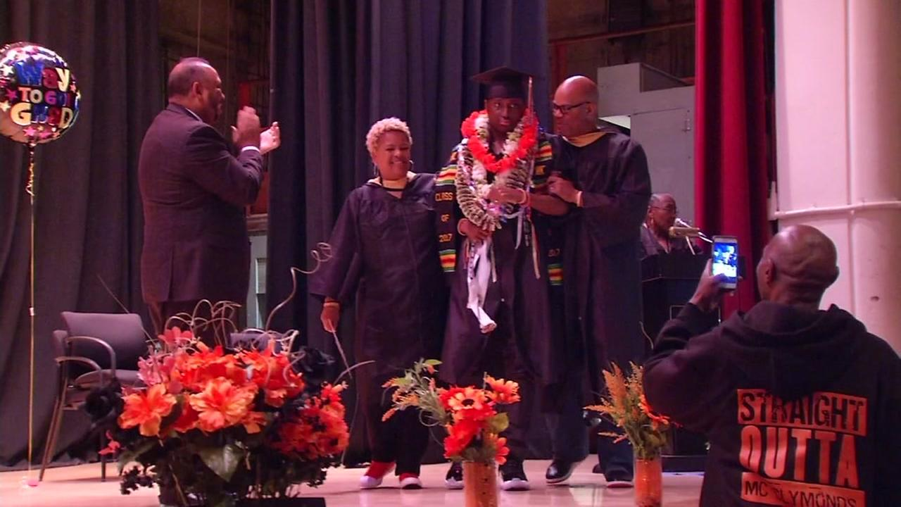 Darryl Aikens is seen crossing the stage at his high school graduation in Oakland, Calif. on Friday, June 9, 2017.