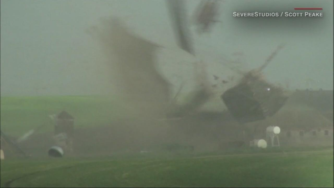 A barn is seen being swept away in a tornado in this undated image.