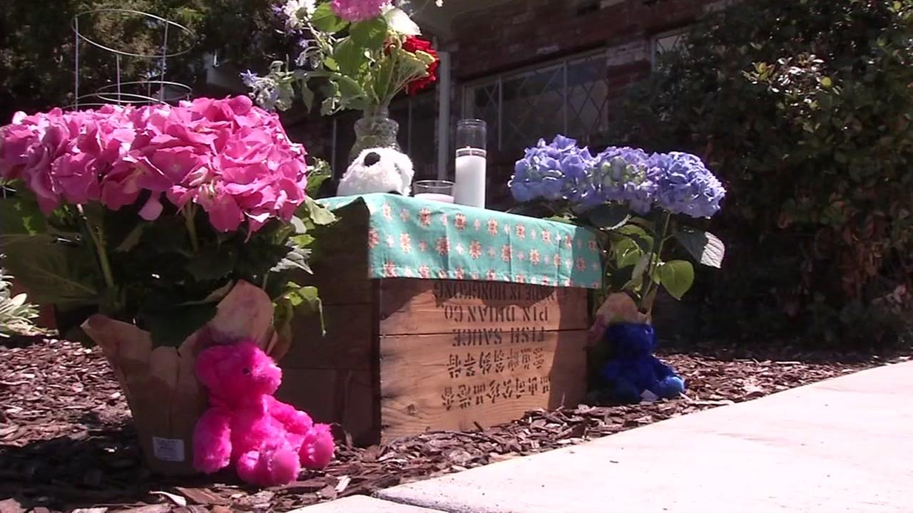 A memorial for two murdered children is seen outside an apartment building in Santa Rosa, Calif. on Tuesday, June 20, 2017.