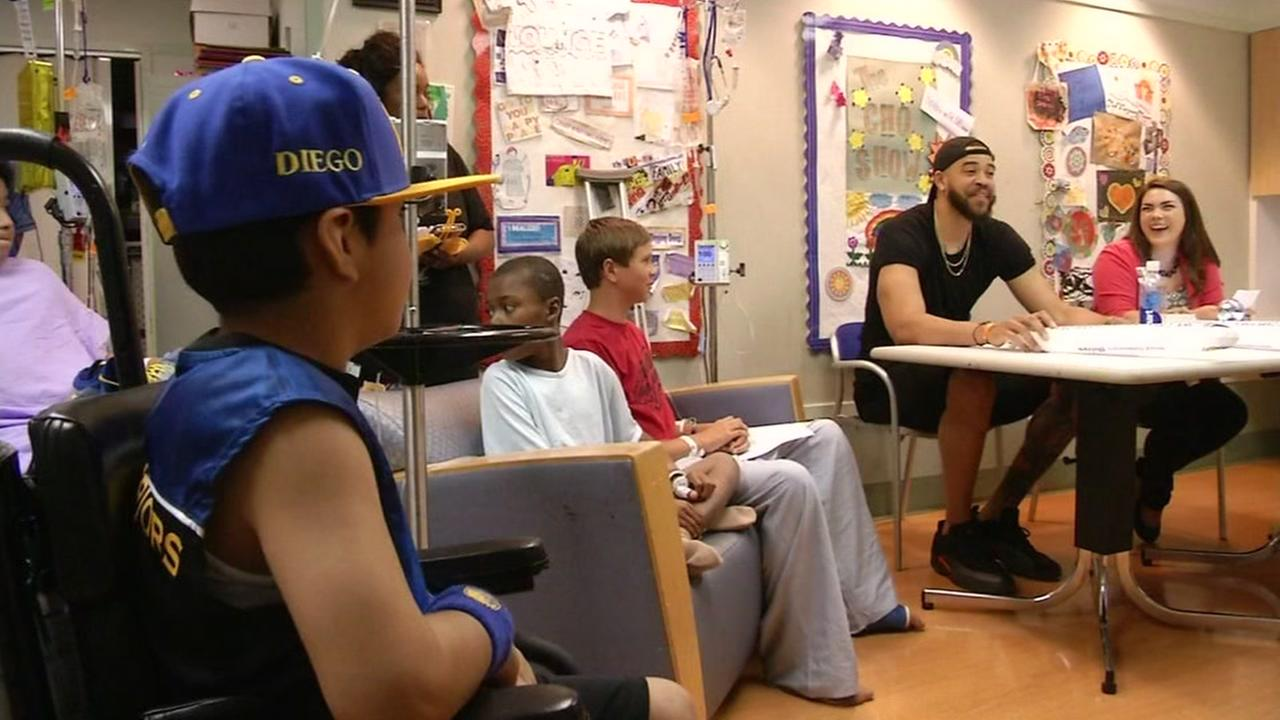Warriors Center Javale McGee visits sick kids at Childrens Hospital in Oakland