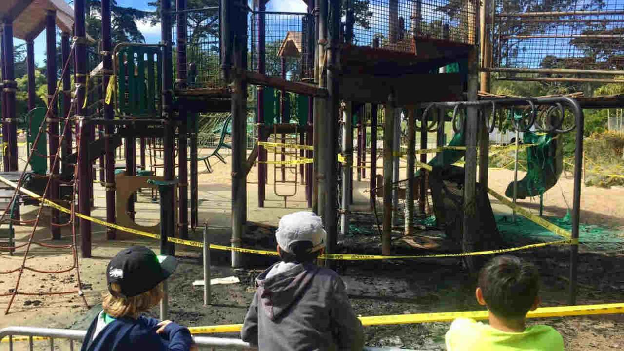 Children look toward a fire-damaged playground structure in San Franciscos Golden Gate Park on Sunday, June 25, 2017.