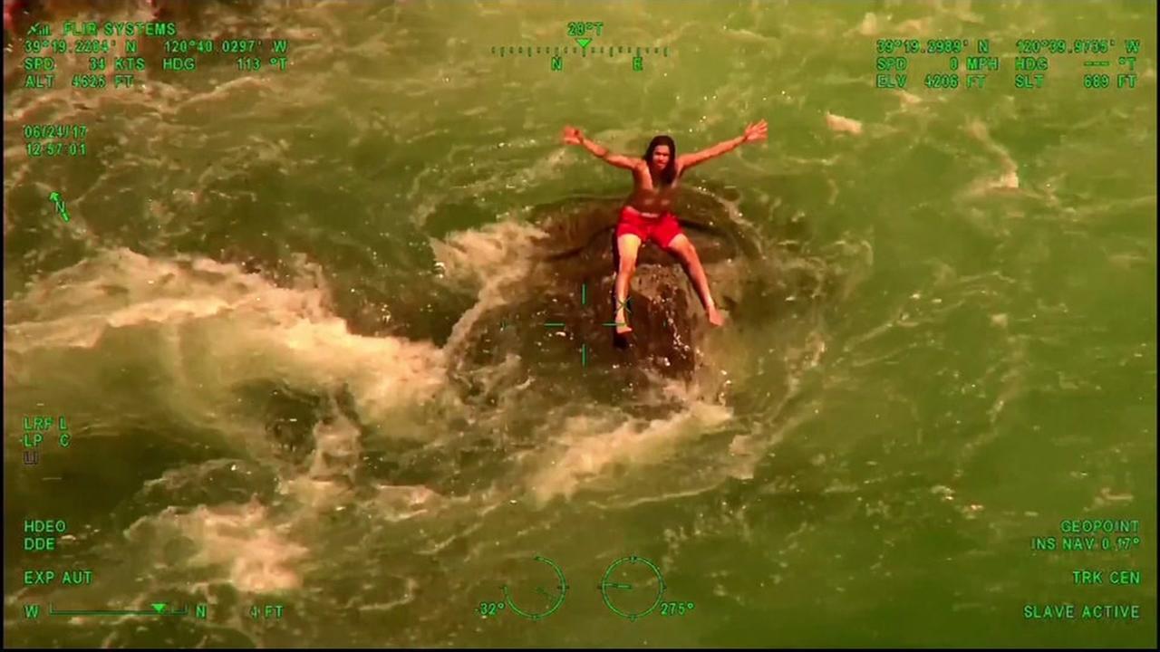 Kalani Tuiono is seen on a rock in the Yuba River on Saturday, June 24, 2017.