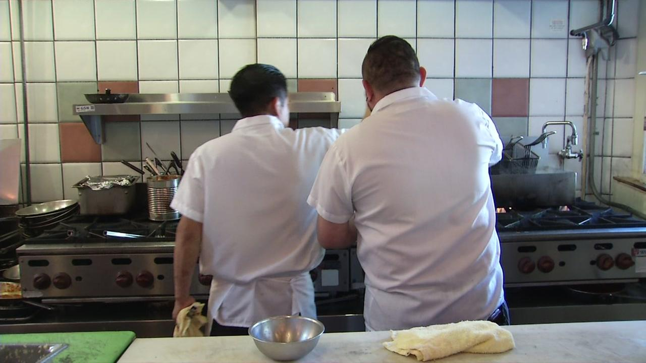 Two restaurant workers appear in this undated image.