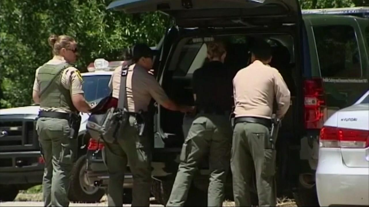 Law enforcement officers are seen after a pot bust in the Santa Cruz Mountains in this undated image.