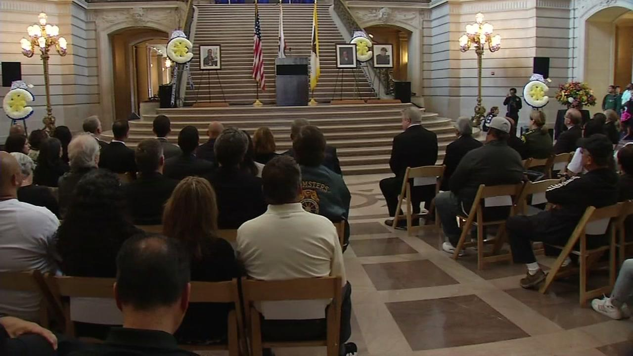 A memorial is seen being held at San Francisco City Hall on Sunday, July 9, 2017 for three men who died in a shooting at a UPS facility.