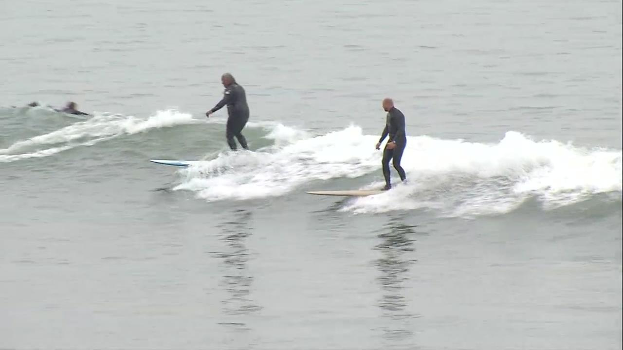Surfers are seen at a beach in Santa Cruz, Calif. on Thursday, July 13, 2017.