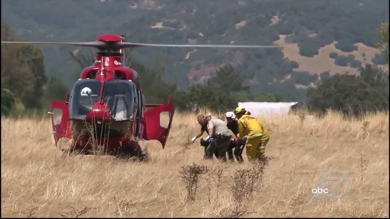 First responders tend to an injured person after a plane crash in Sonoma County, Calif. on Thursday, July 13, 2017.
