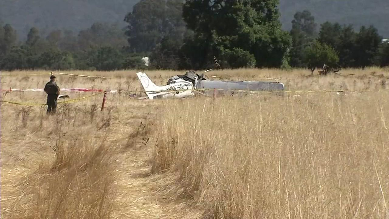 An investigator stands near the wreckage of a small plane in Sonoma County, Calif. on Friday, July 14, 2017.