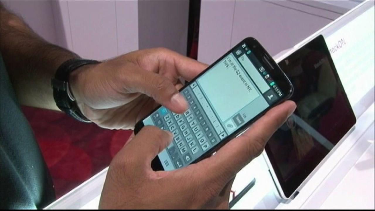 A person holding a smartphone is seen in this undated image.