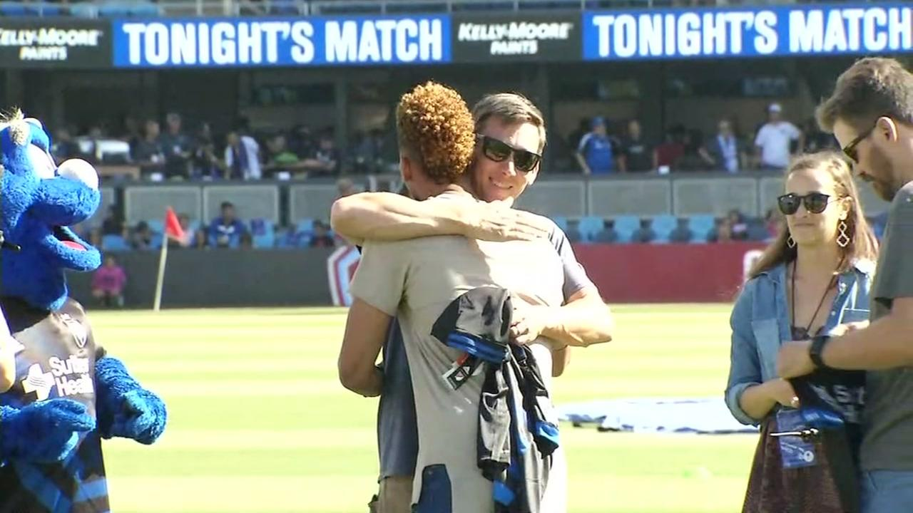 San Jose Earthquakes player Matheus Silva is seen on Saturday, July 29, 2017 hugging one of three people who rescued him from drowning in Lake Tahoe.