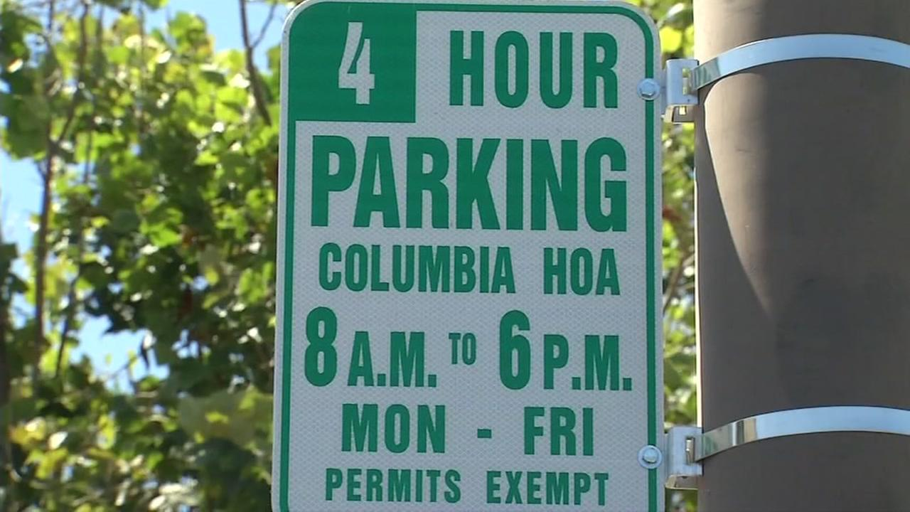 A parking restriction sign is seen in Alameda, Calif. on Monday, July 31, 2017.