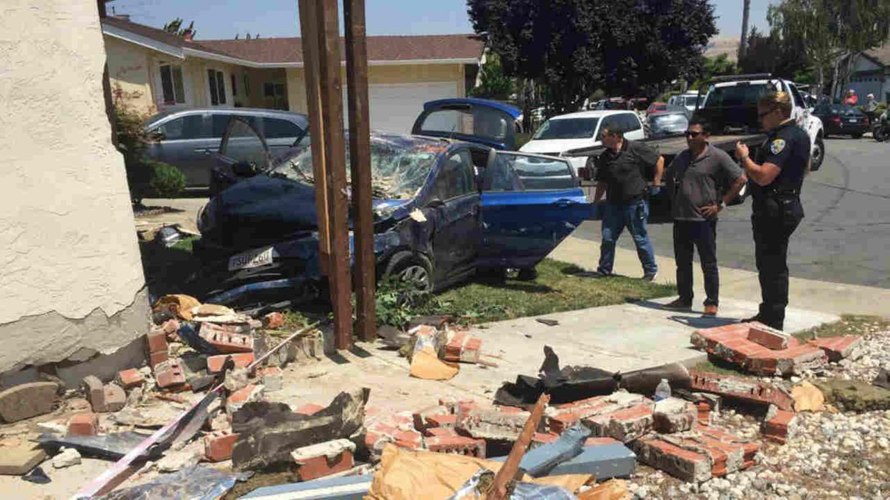 A car is seen after burglary suspects crashed into a home in Fremont, Calif. on Tuesday, August 1, 2017.