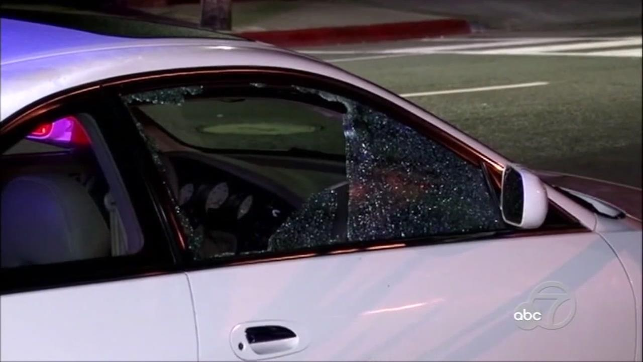 A cars window is smashed on I-880 in San Leandro, Calif. on Monday, August 14, 2017.