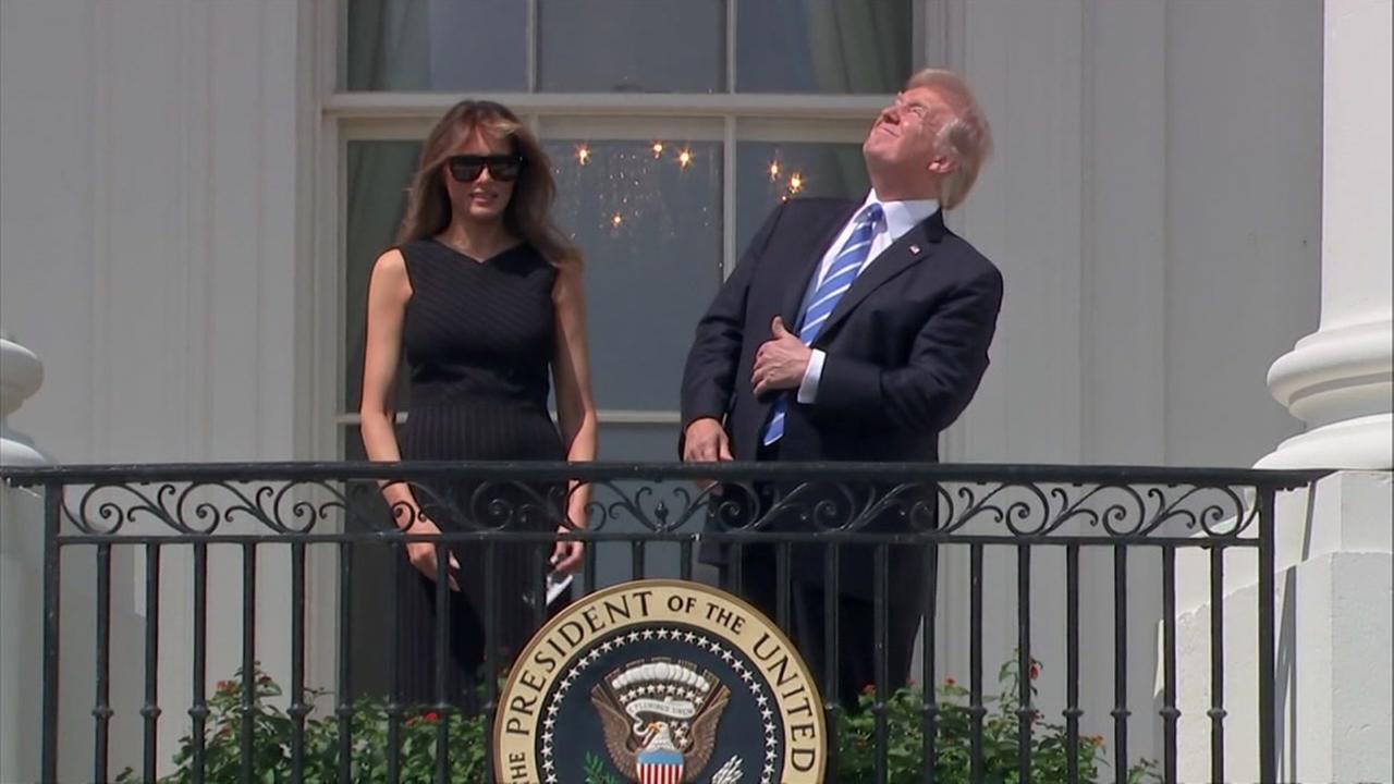 President Donald Trump and First Lady Melania Trump watch the solar eclipse in Washington on Monday, Aug. 21, 2017