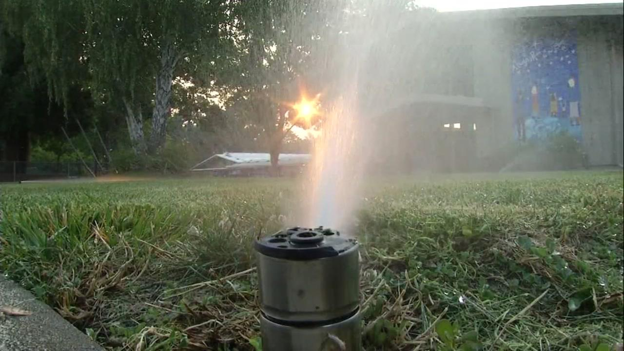 A sprinkler is seen outside a school in this undated image.