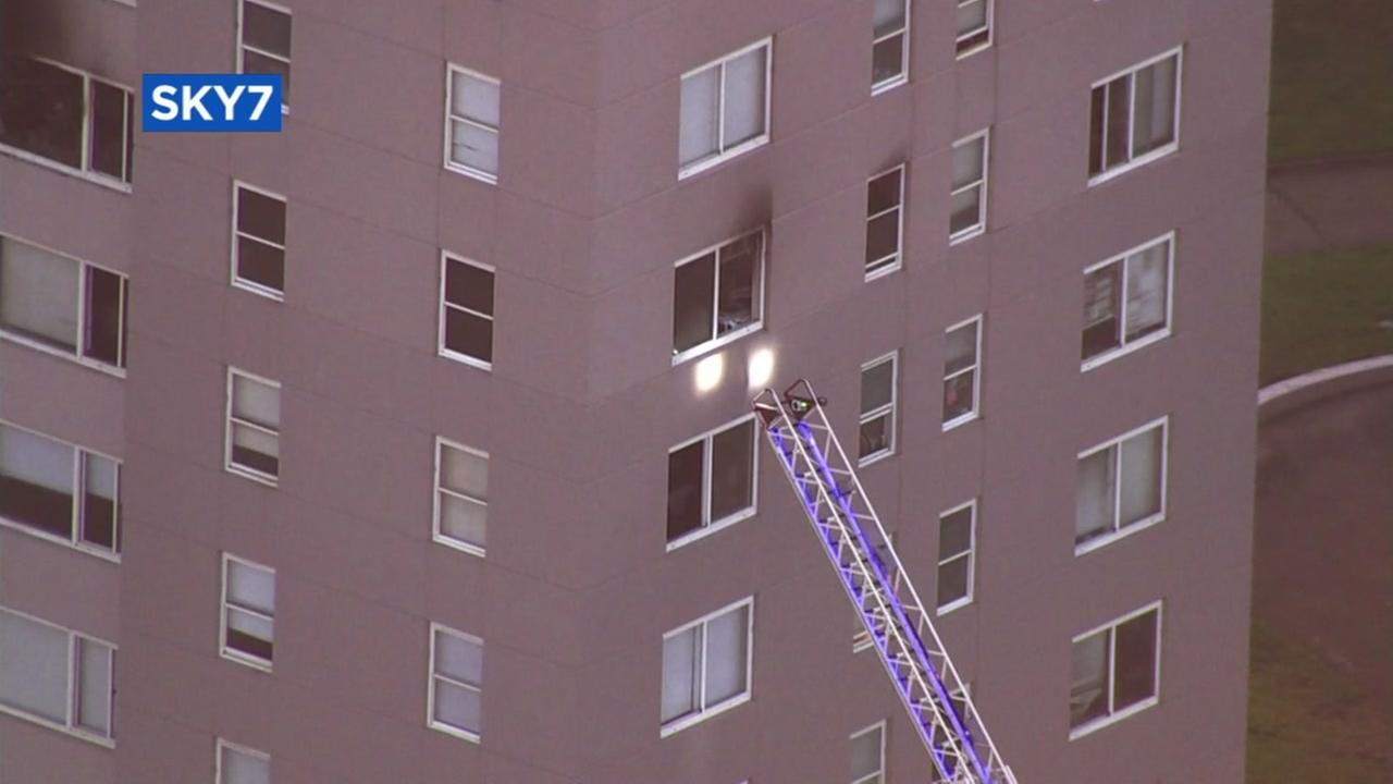 San Francisco firefighters rescue three from apartment complex fire