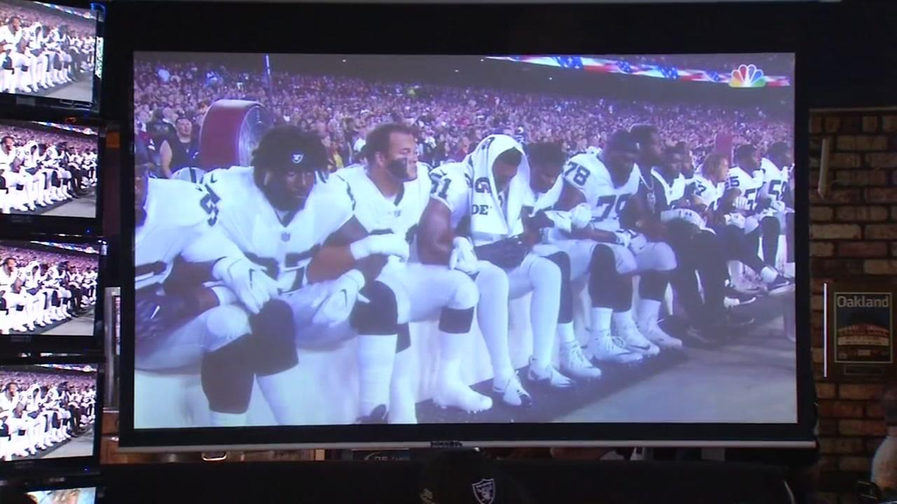 The Oakland Raiders are seen sitting during the national anthem before a game on Sunday, September 24, 2017.
