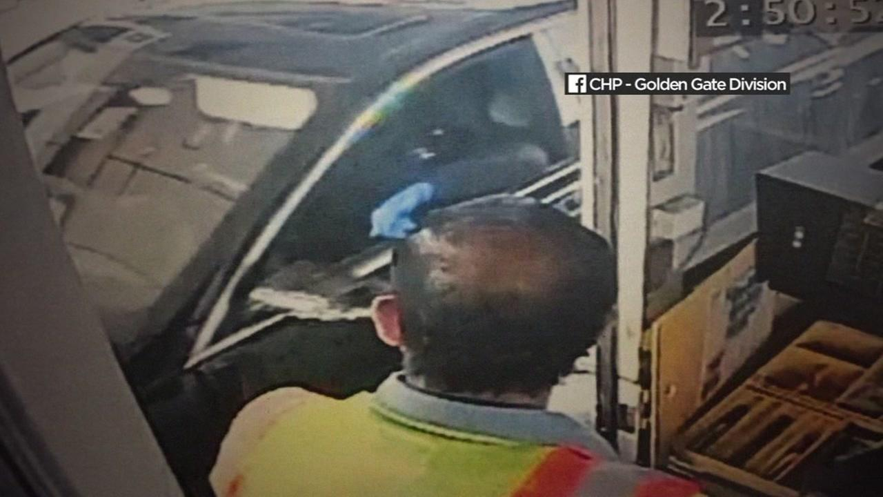A pair of suspects are seen holding up a toll booth at a Bay Area bridge on Sunday, September 24, 2017.