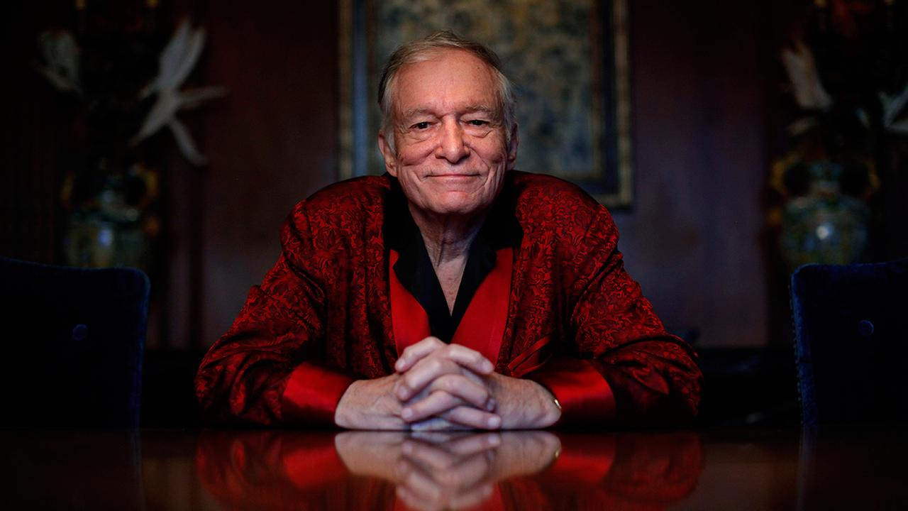 FILE - In this Nov. 4, 2010, file photo, Playboy magazine founder Hugh Hefner poses for photos at the Playboy Mansion in Los Angeles.