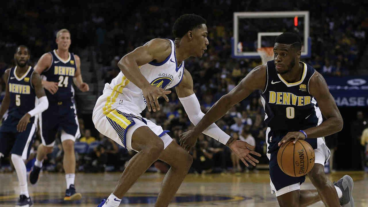 Golden State Warriors Nick Young, left, guards Denver Nuggets Emmanuel Mudiay (0) during the first half of a NBA basketball game Saturday, Sept. 30, 2017, in Oakland, Calif.
