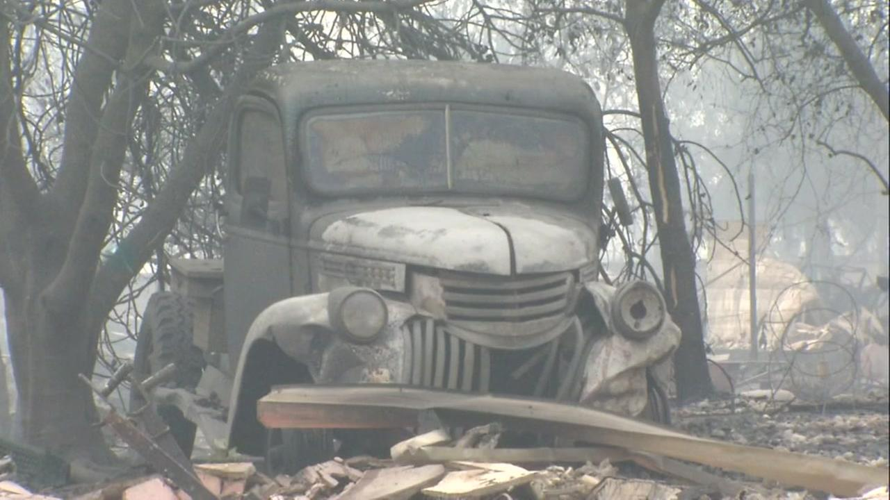 The burnt out exterior of a car appears in Santa Rosas Coffee Park neighborhood on Tuesday, Oct. 10, 2017.