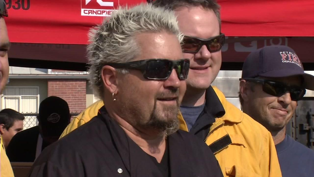 Celebrity chef Guy Fieri stands first responders in Santa Rosa, Calif. on Thursday, October 12, 2017.