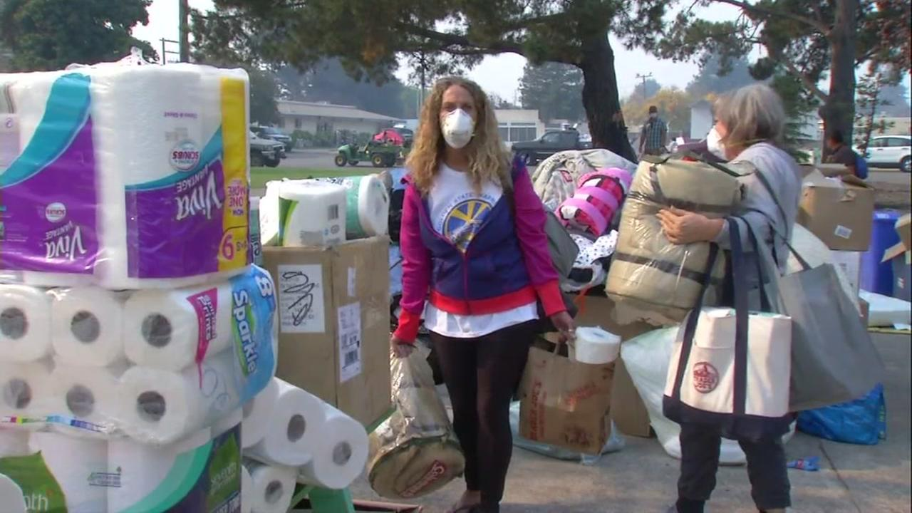 North Bay fire evacuees gather supplies in Petaluma, Calif. on Friday, Oct. 13, 2017.