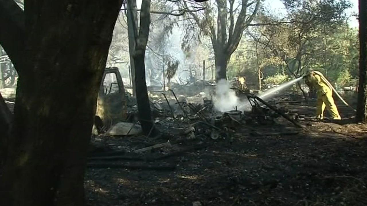 This is an image of a firefighter putting out hot spots in Sonoma, Calif. on Saturday 14, 2017