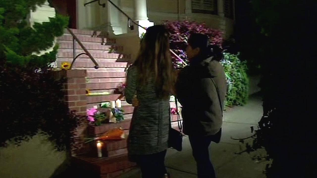 Robin Williams fans stand outside the San Francisco home used in the filming of the movie Mrs. Doubtfire