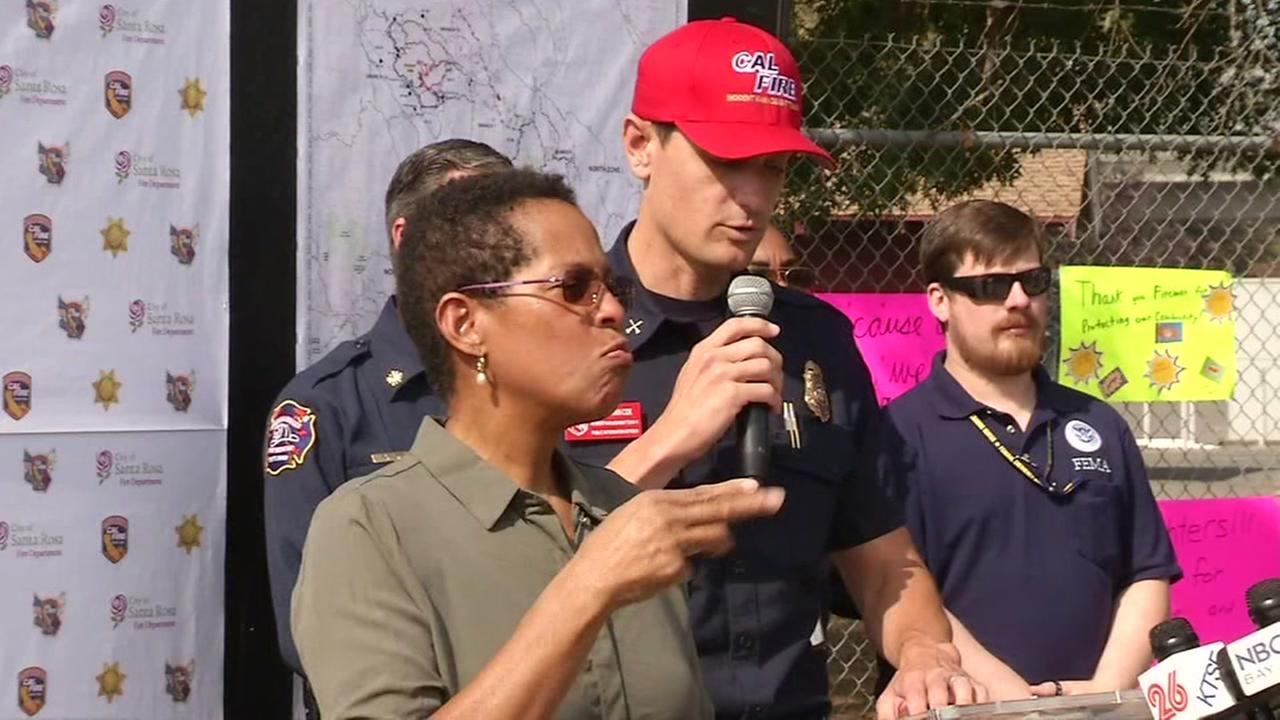 A sign language interpreter is seen at a wildfire briefing in Santa Rosa, Calif. in this undated image.