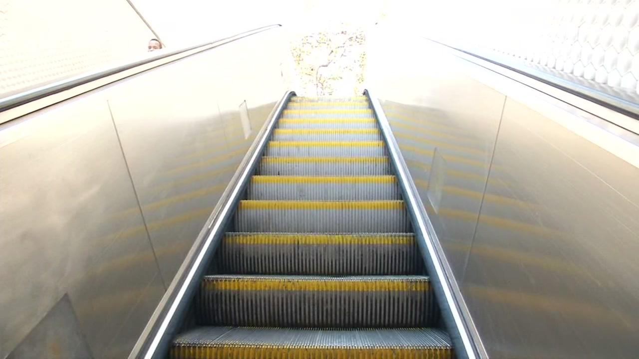A BART escalator appears in this undated image.