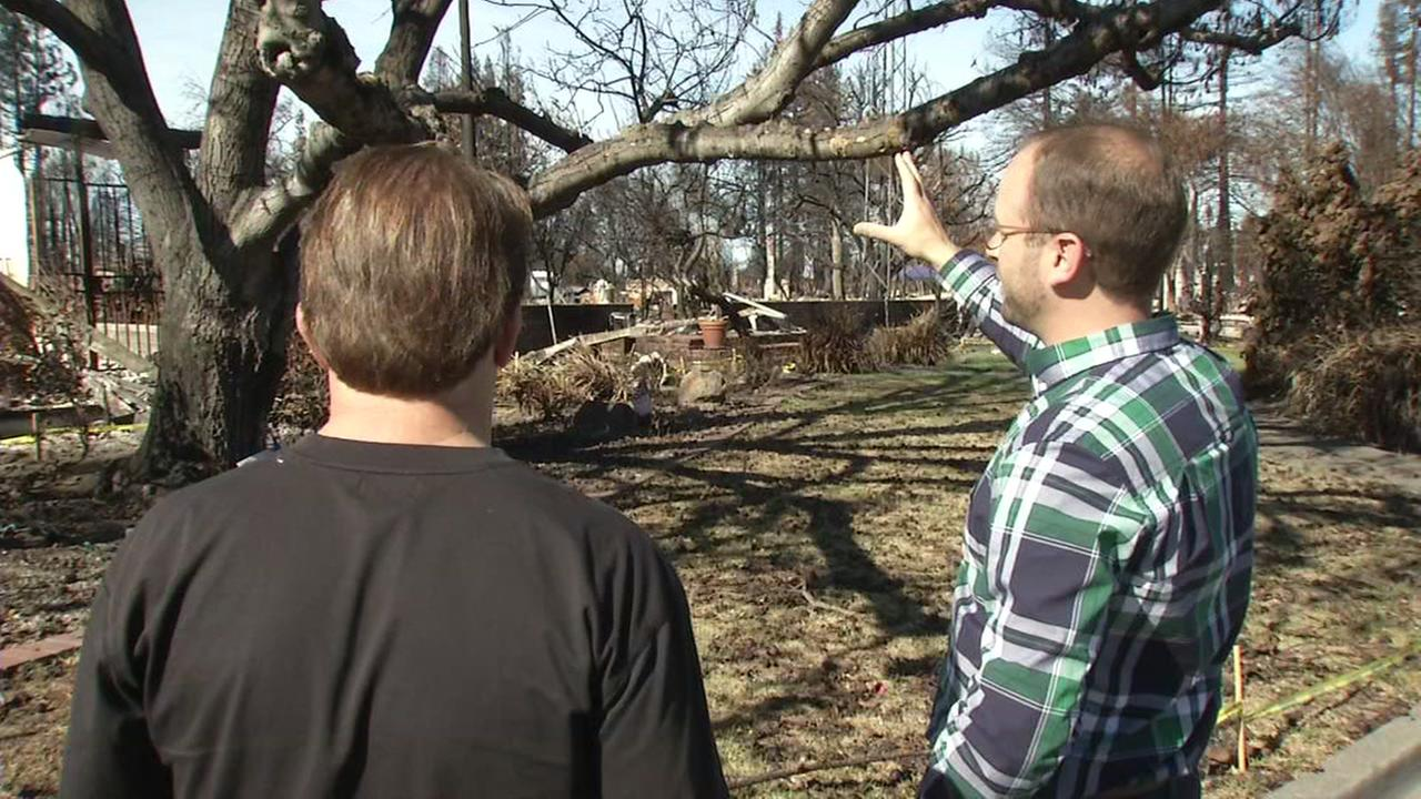 This is an undated image of people surveying fire damage in Napa Co.