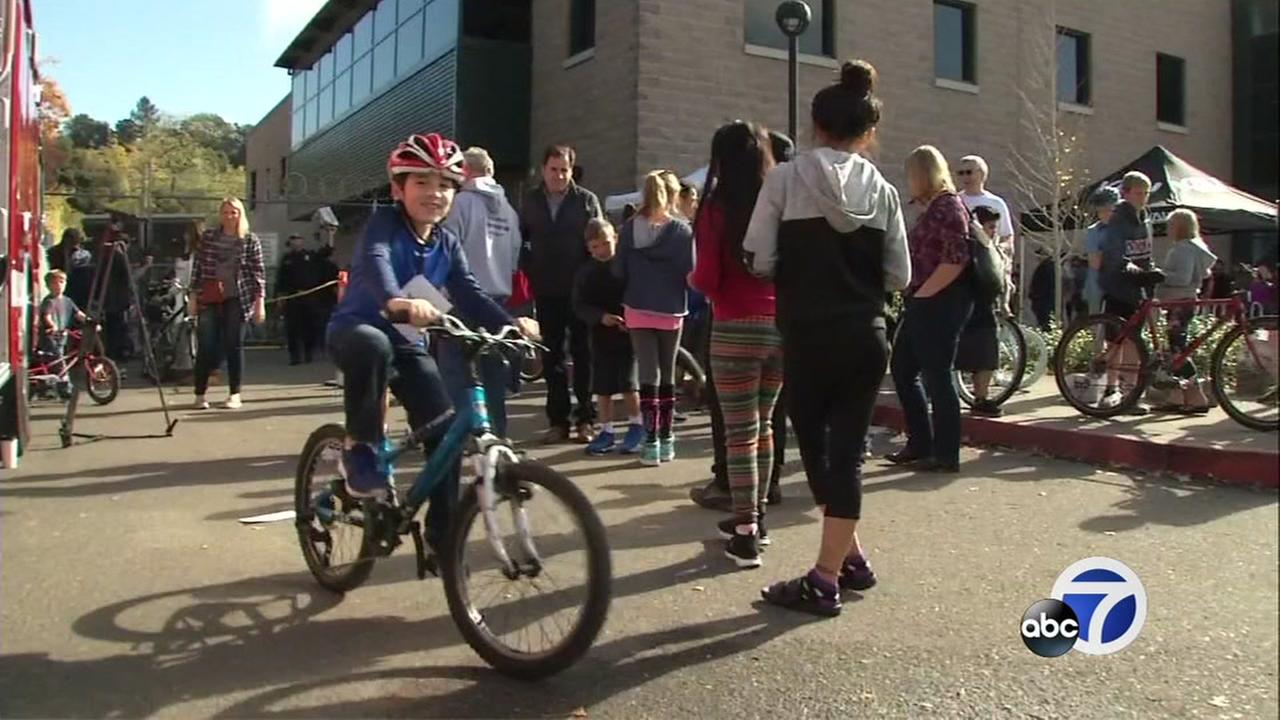 This is an image of a boy riding a donated bike at the Sonoma Strong concert fundraiser in Sonoma, Calif. on Saturday, November 11, 2017.