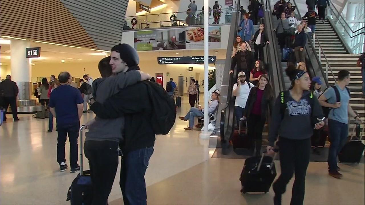 Travelers embrace at San Jose Mineta International Airport in San Jose, Calif. on Wednesday, Nov. 22, 2017.
