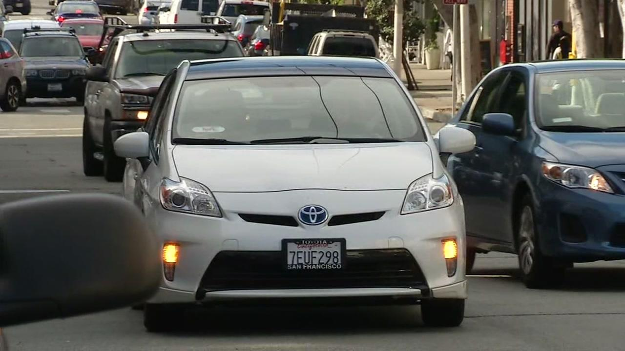 A rideshare vehicle is seen double parking in San Francisco in this undated image.
