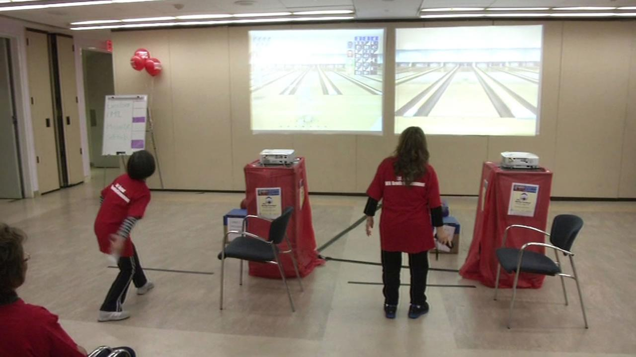 Seniors virtual bowling at the San Francisco Main Library.