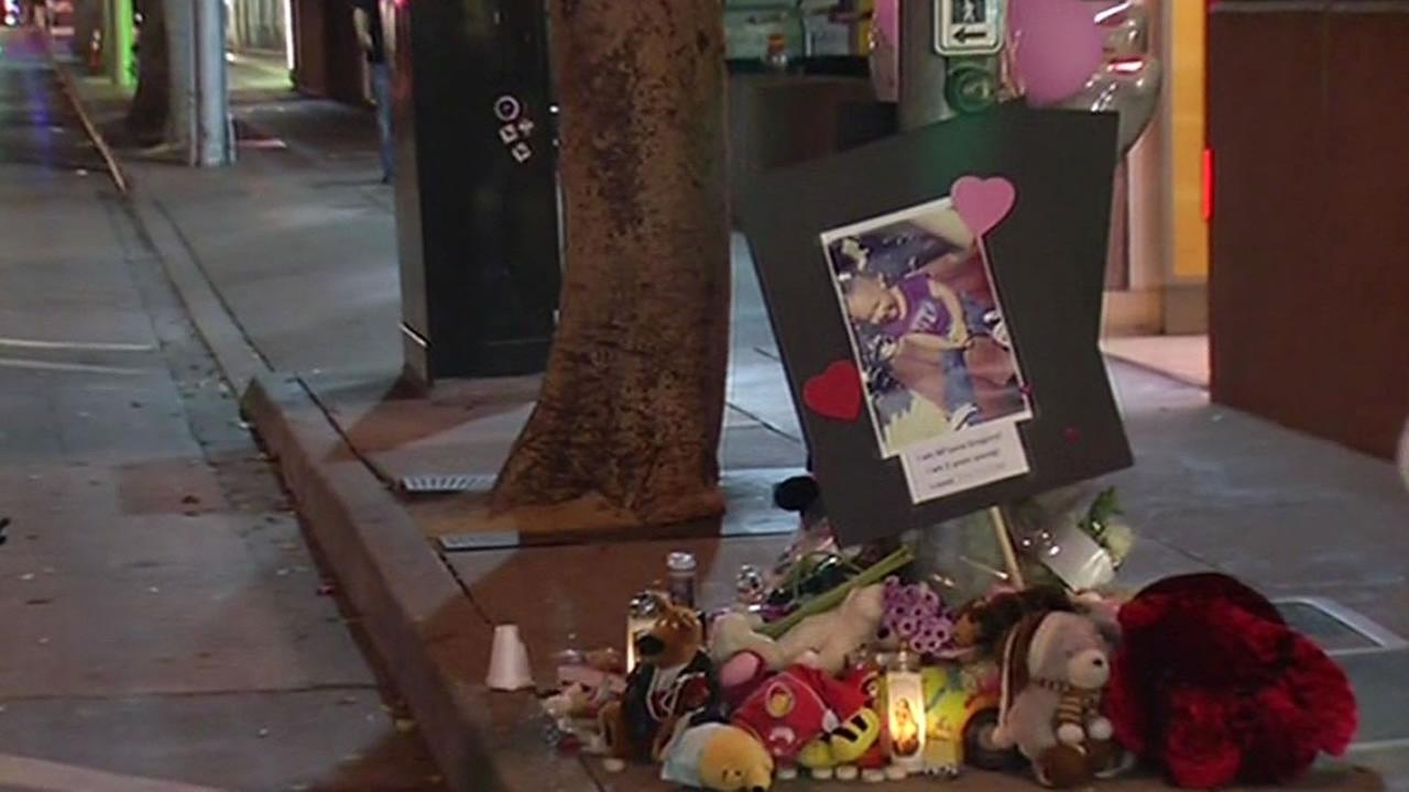 memorial is growing with flowers and candles at the site where 2-year-old Miyana was struck and killed