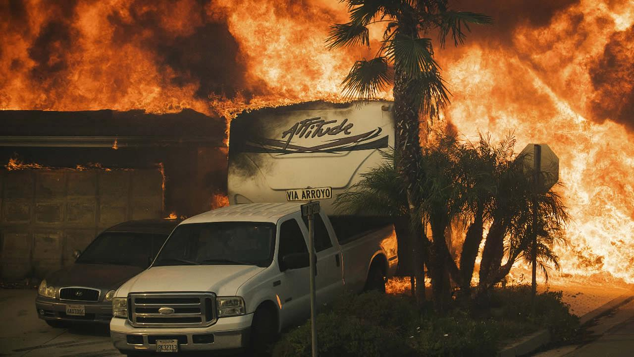 Flames consume a home on Via Arroyo as a wildfire rages in Ventura, Calif., on Tuesday, Dec. 5, 2017. (AP Photo/Noah Berger)