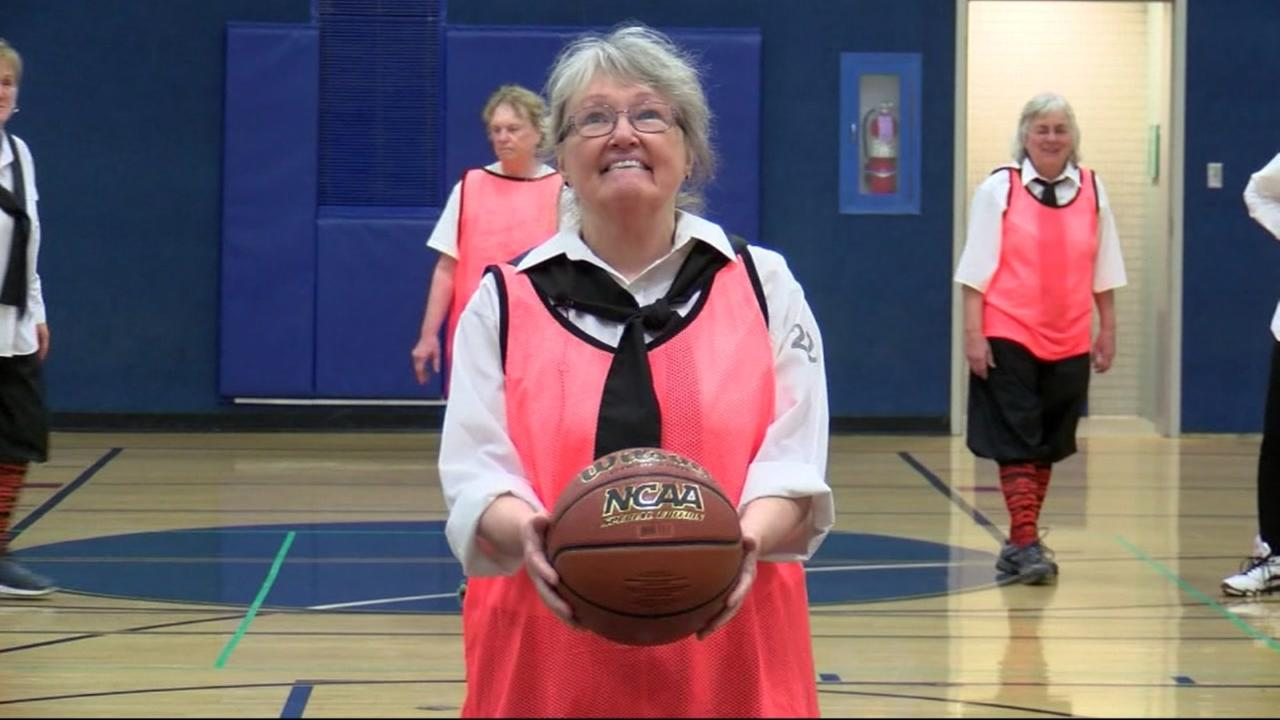 This is an undated image of an elderly woman playing basketball