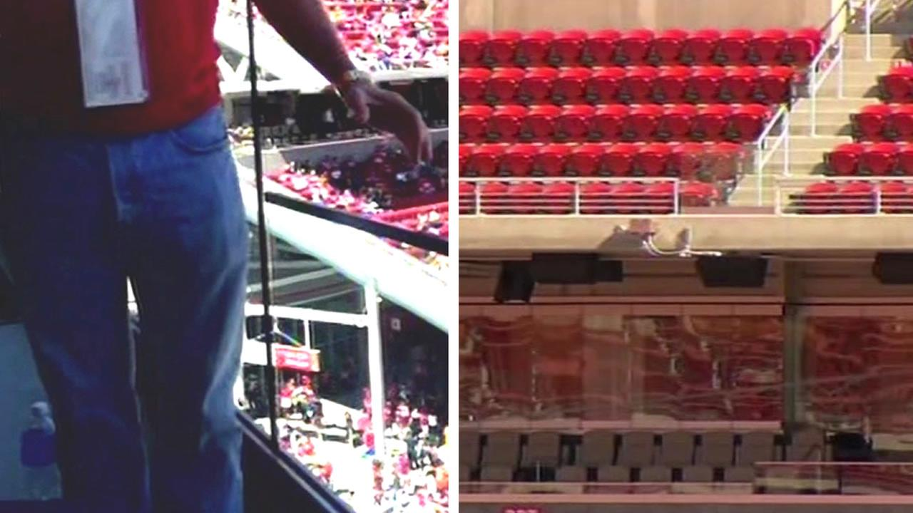 Personal injury attorney Chris Dolan takes a photo standing next to a short railing at Levis Stadium