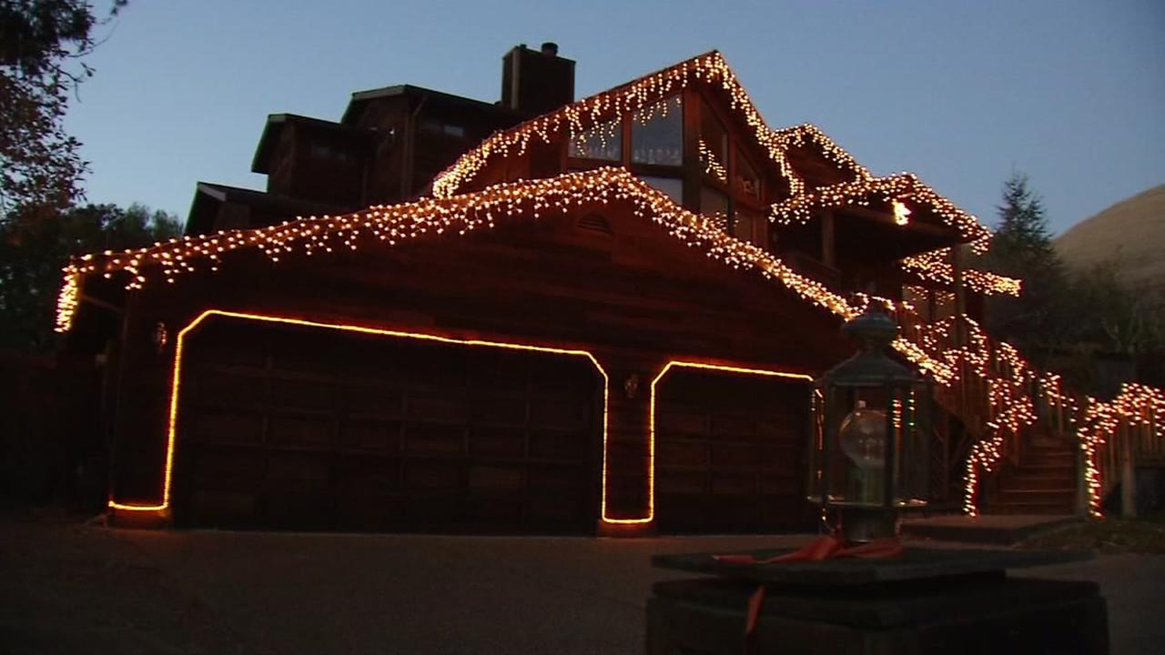 A Novato, Calif. home is lit up in orange lights in honor of Las Vegas shooting victim Stacee Etcheber on Thursday, Dec. 14, 2017.