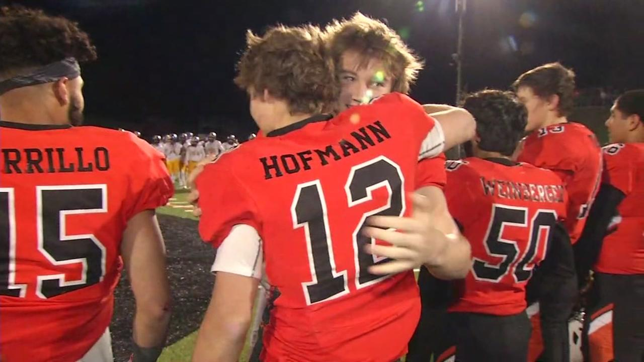 Two Half Moon Bay football players embrace in this undated image.