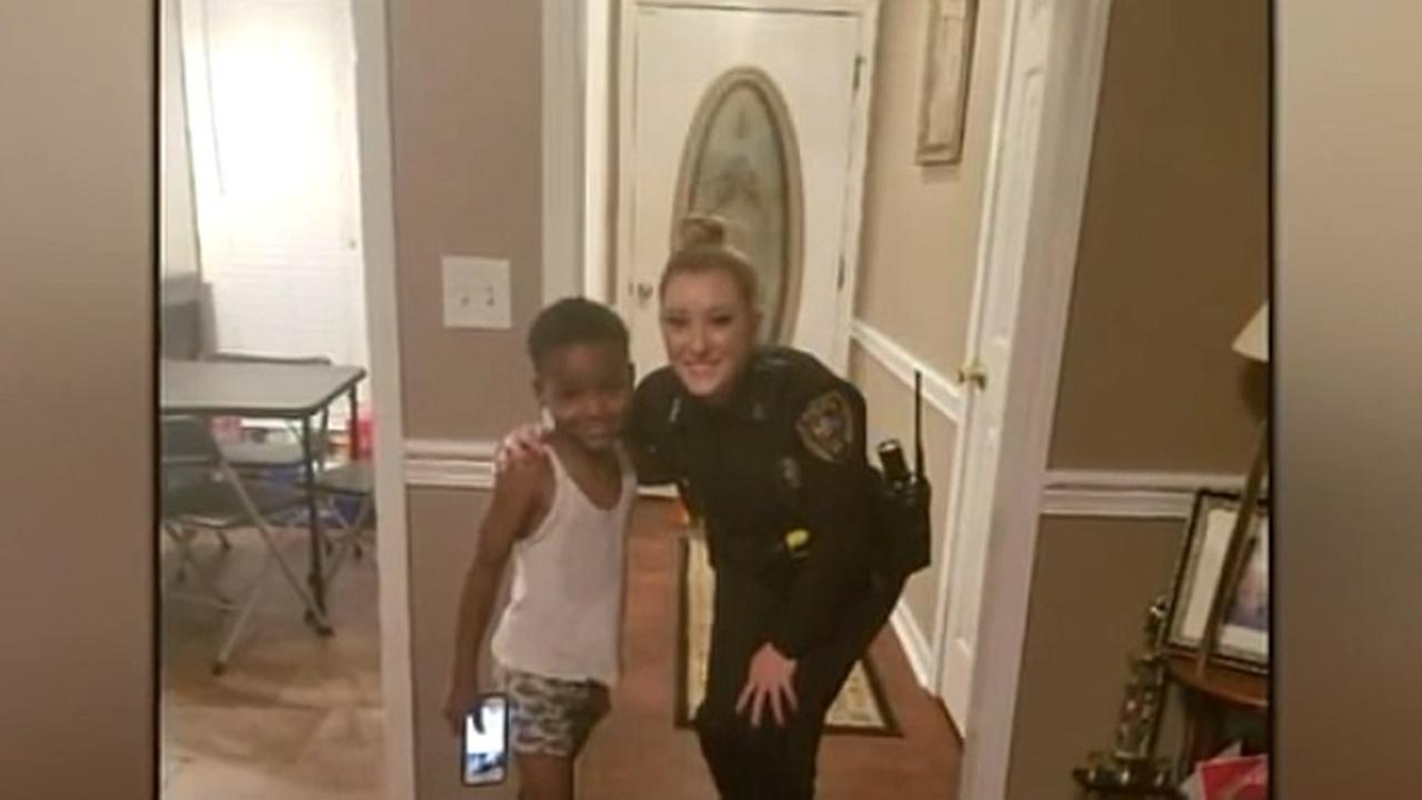 A boy named TyLon Pittmanm is seen next to a Mississippi officer in this undated image.