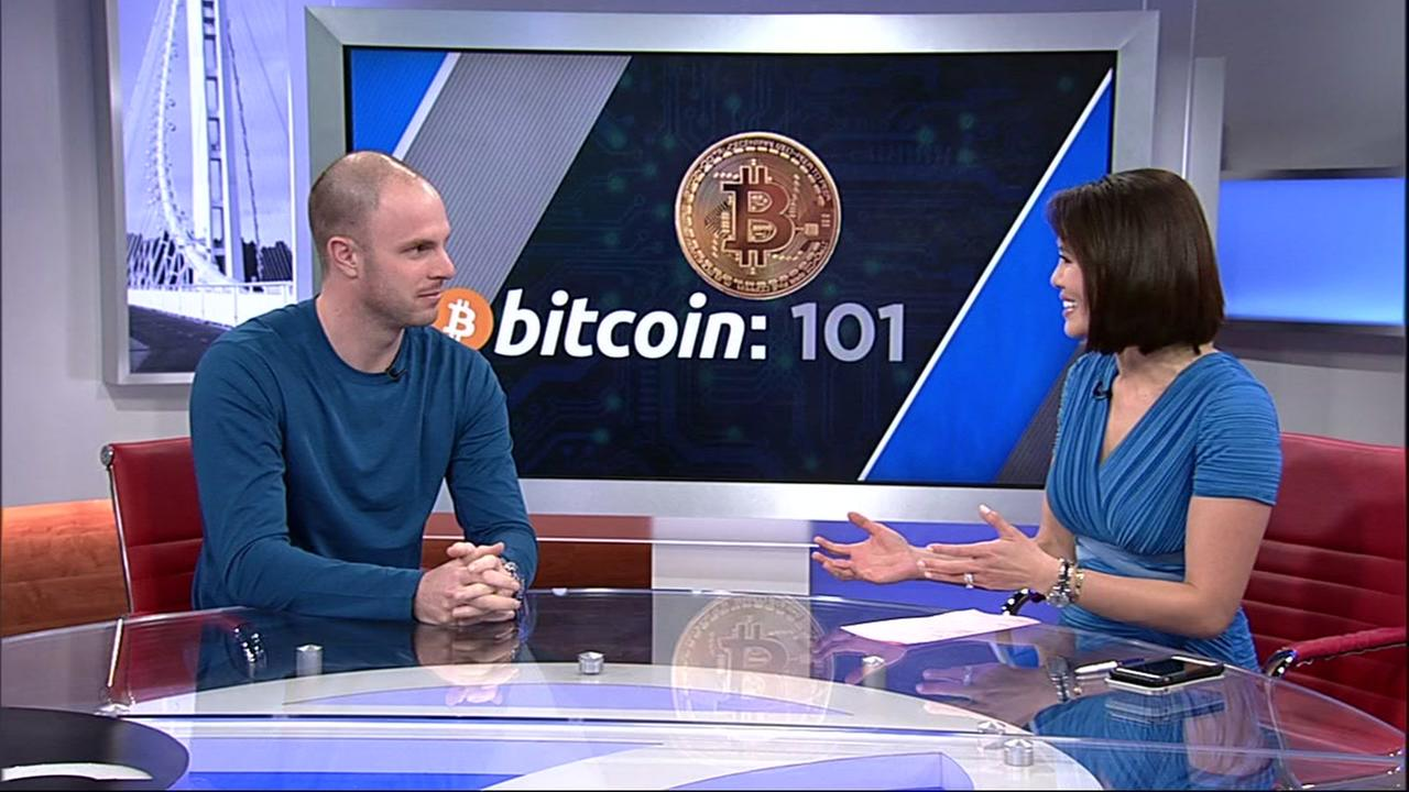 Jason Les, director for Riot Blockchain, is seen with ABC7 News Anchor Dion Lim in San Francisco on Tuesday, Dec. 19, 2017.