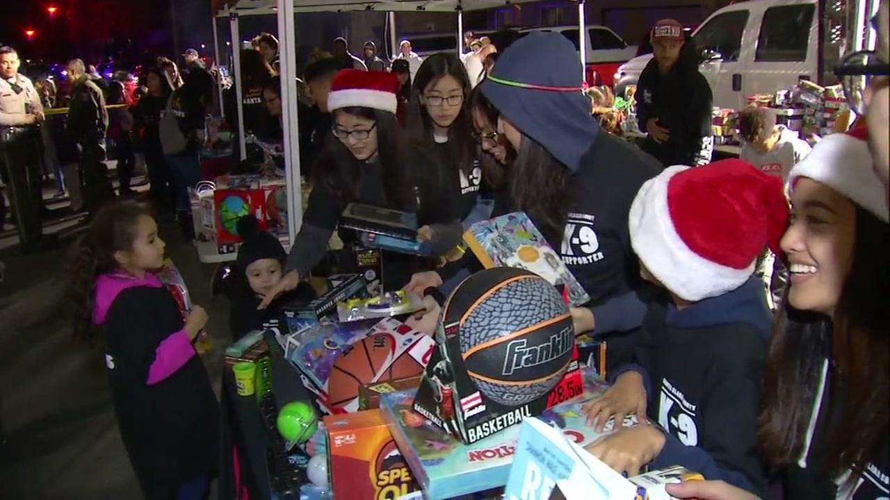 Children receive gifts in San Jose, Calif. on Friday, Dec. 22, 2017.