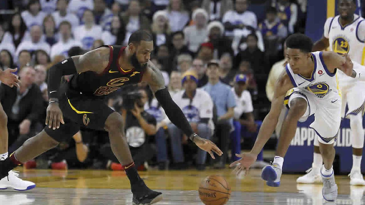 LeBron James chases a basketball during the Christmas Day matchup against the Golden State Warriors in Oakland, Calif. on Monday, Dec. 25, 2017.